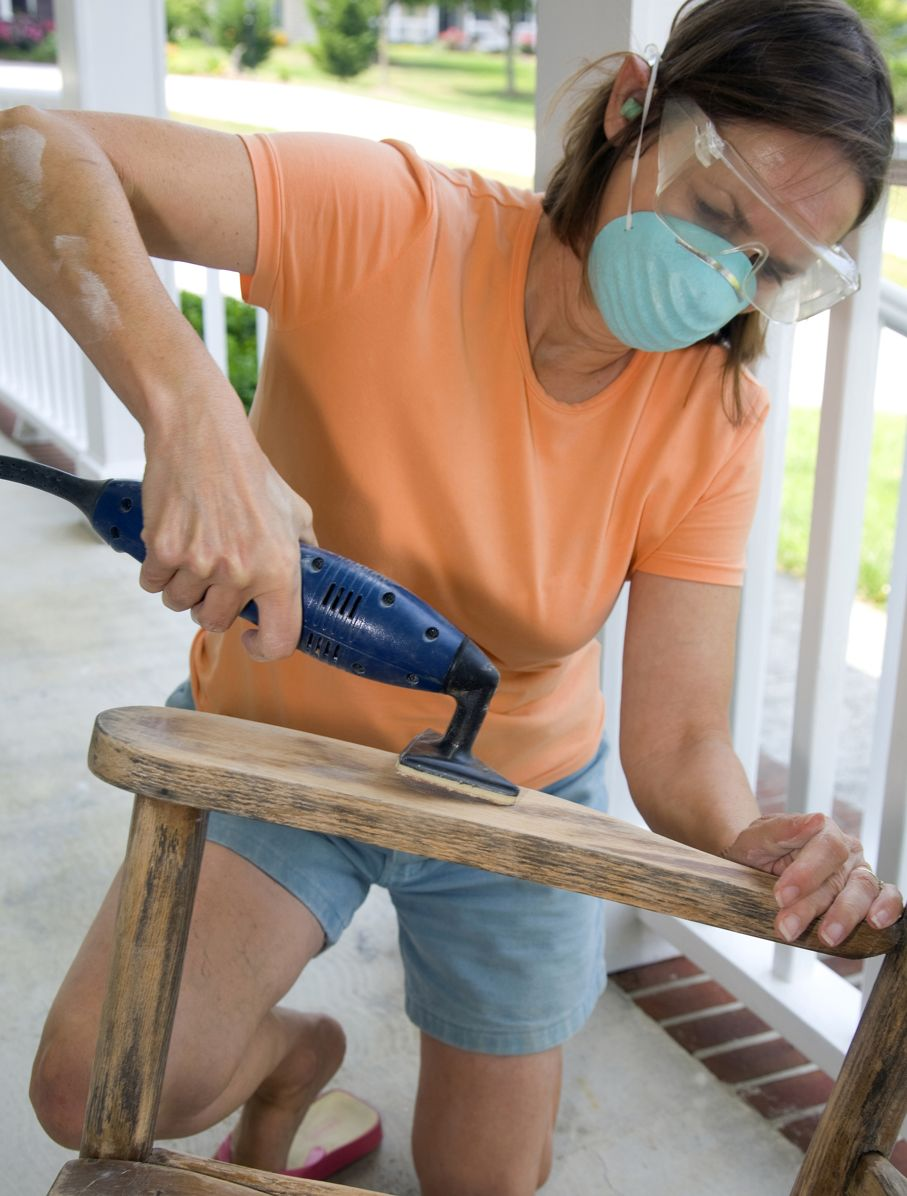 Woman Refinishing Furniture
