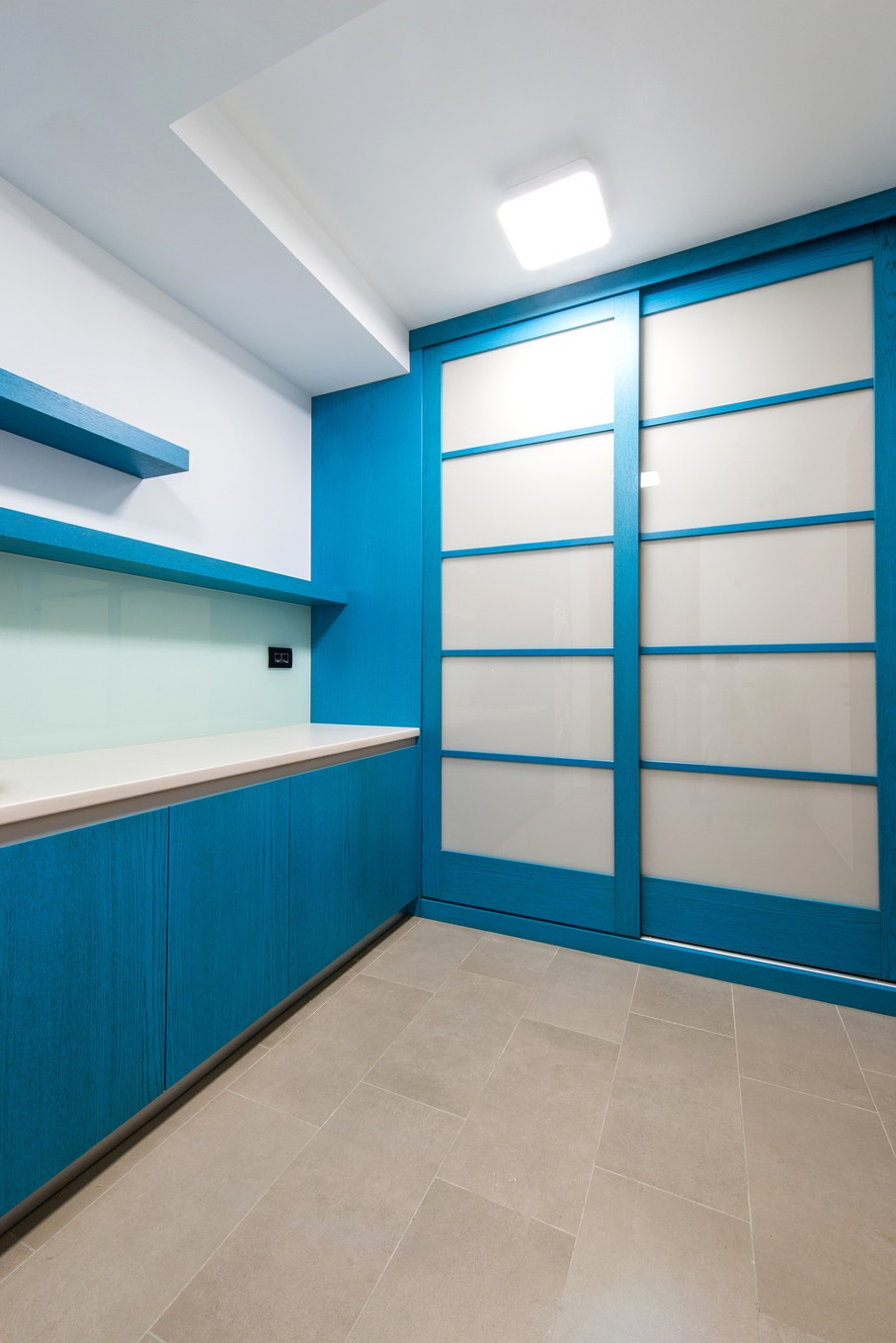 Empty laundry room with closet and shelves in modern home interor