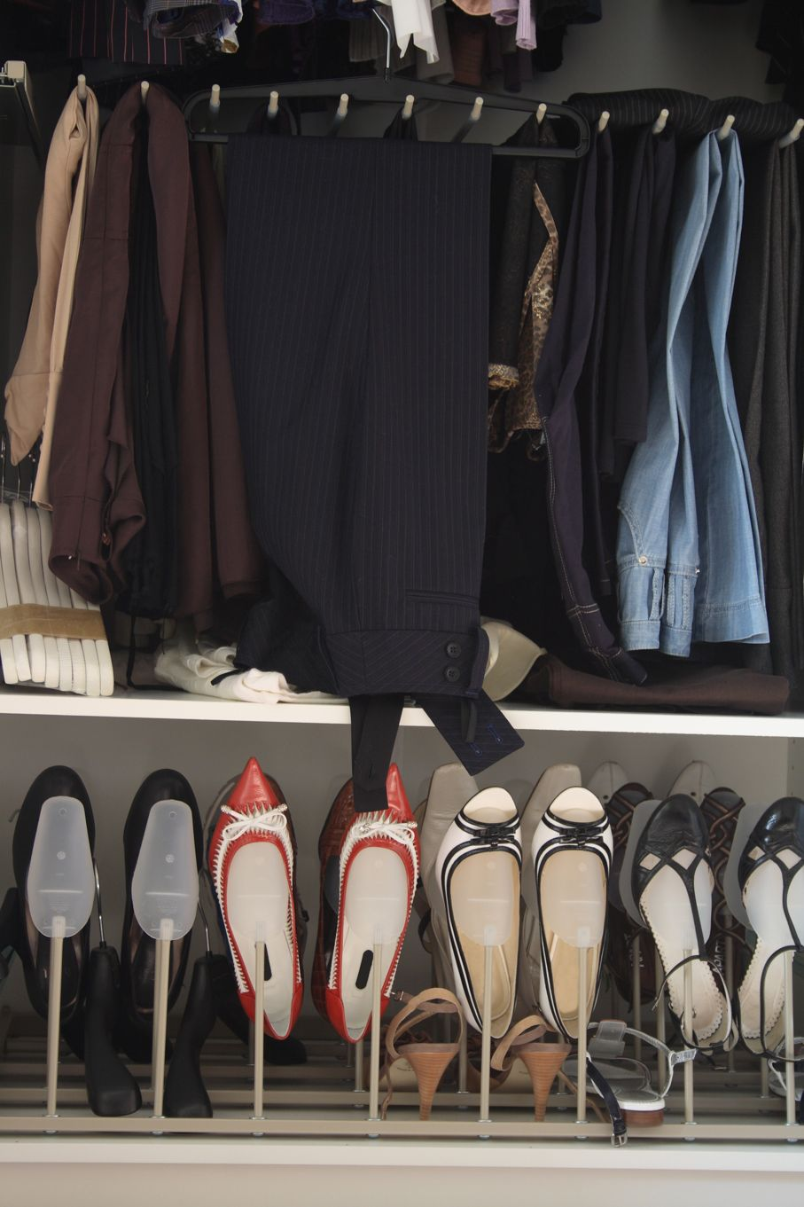 Opened women's wardrobe with clothes and shoes