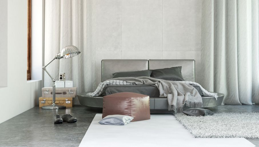 Stylish modern bedroom interior with grey decor