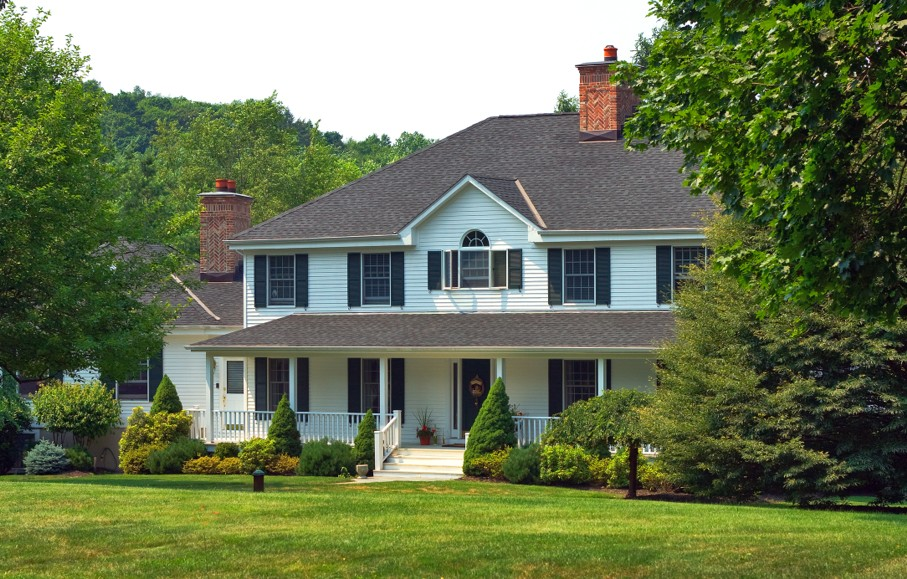 View of the exterior and front yard of a surburban home