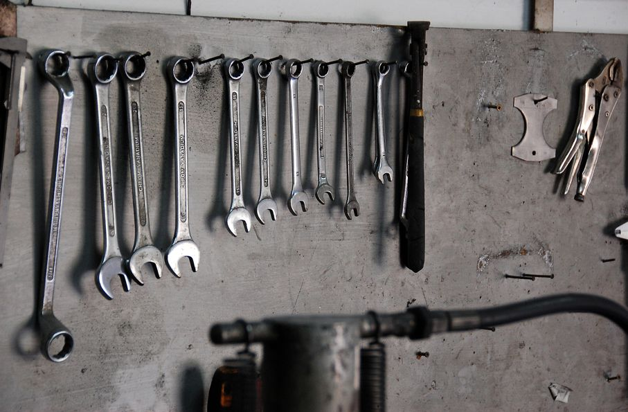 Mechanic tools hanging on a organized wooden board
