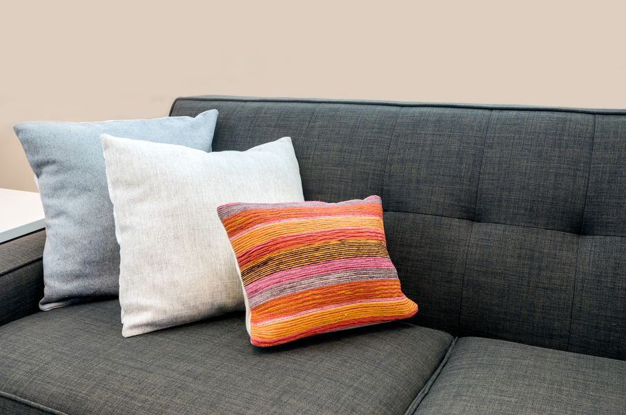Interior design with couch sofa with colorful cushions pillows