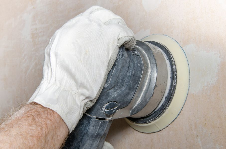 Sanding of a wall with a power sander
