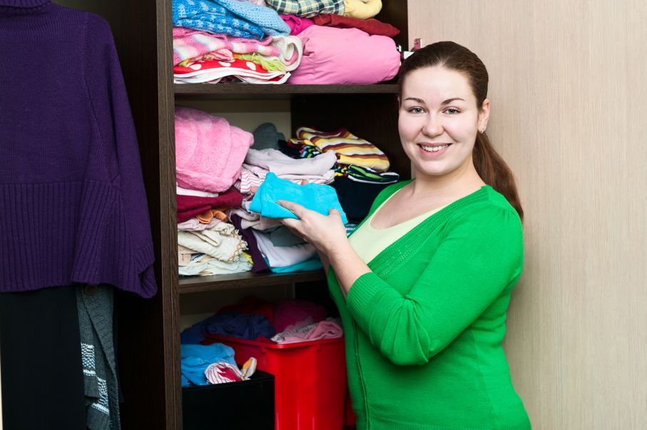 Young caucasian woman in the wardrobe