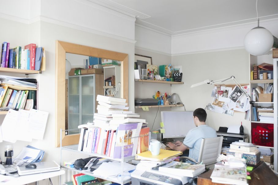 Rear view of man in cluttered room