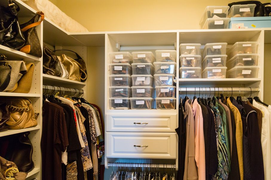 A well organized closet with custom shelves and bins