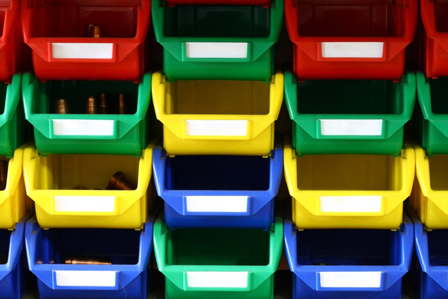 A photo of colorful plastic containers with blank labels