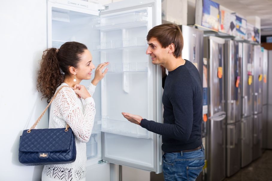 Couple choosing new refrigerator