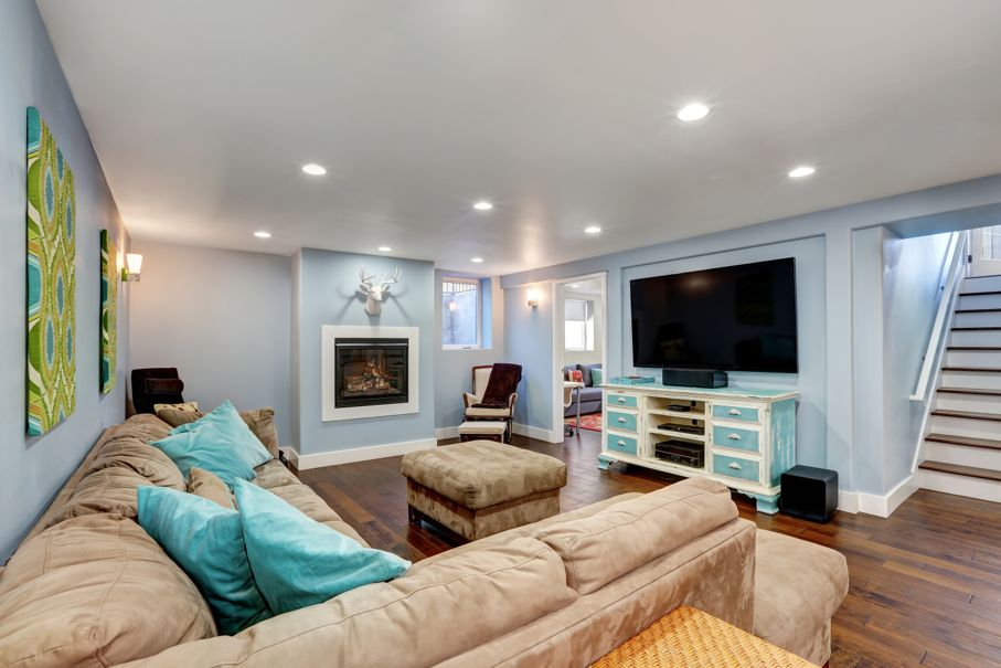 Pastel blue walls in basement living room interior