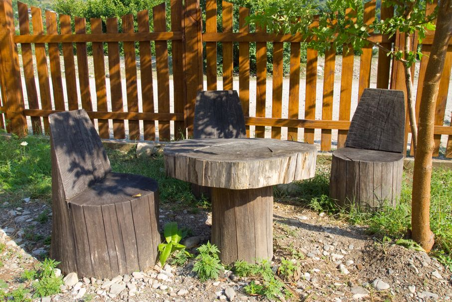 Table and chair of tree trunks in the garden