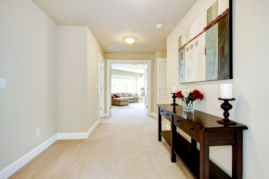Large home hallway with art and furniture