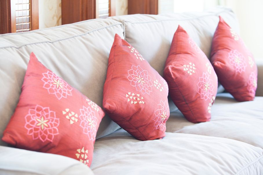 Fabric sofa with red pillows