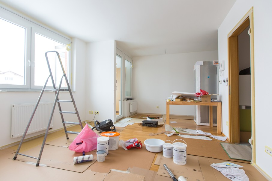 Home renovation in room full of painting tools