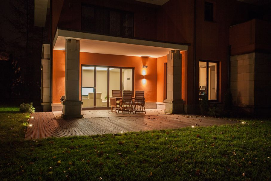 Travertine house - illuminated patio with garden