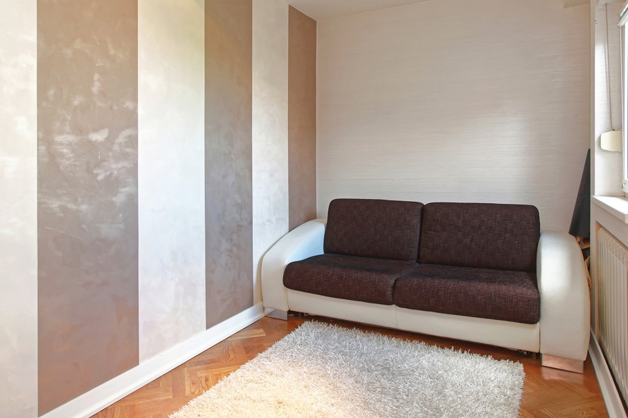 Brown Sofa in Small Room With Striped Wall