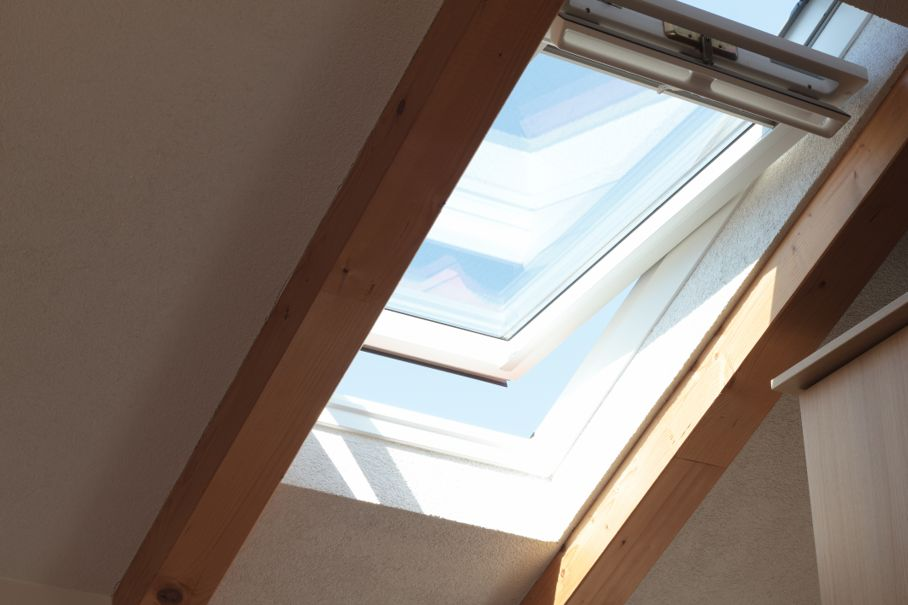 Shot of opened skylight window on a blue sky day