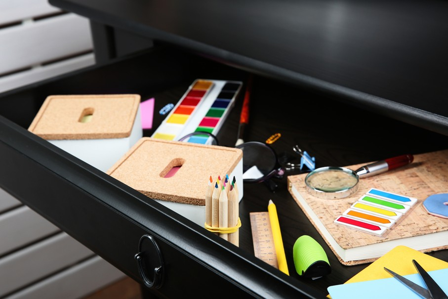 Stationery in open desk drawer