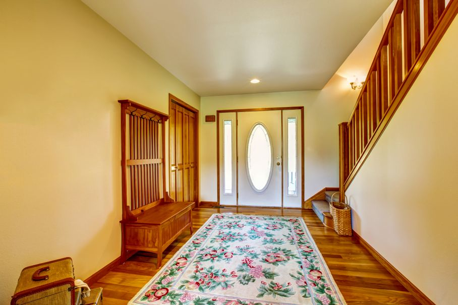 Hallway interior of country house with colorful rug