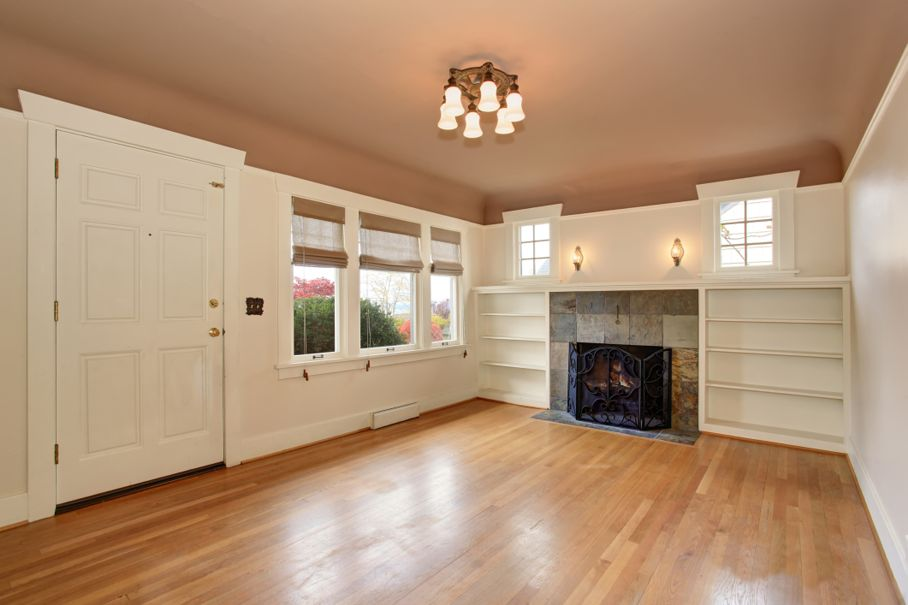 Living room interior with mocha ceiling and tile trim fireplace