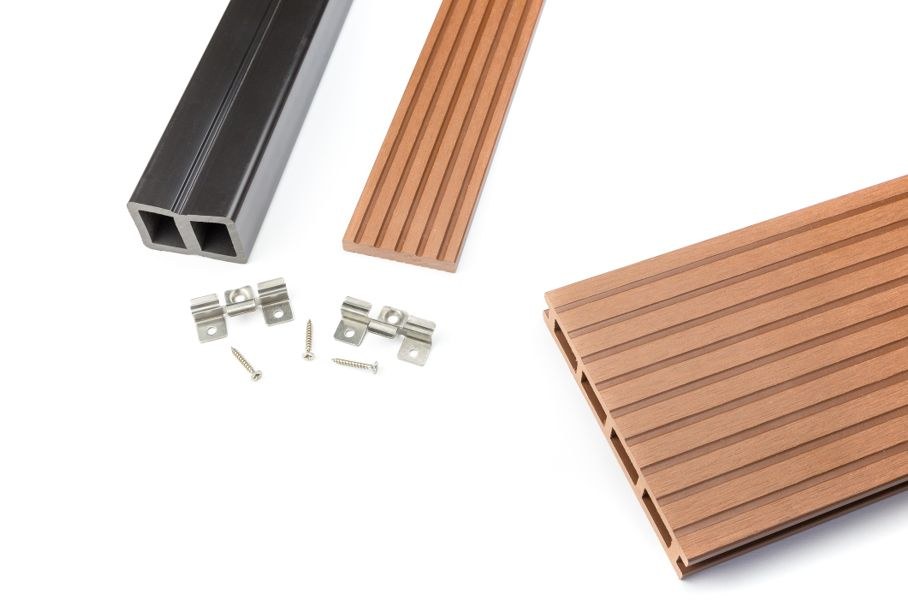 Composite decking board with mounting material