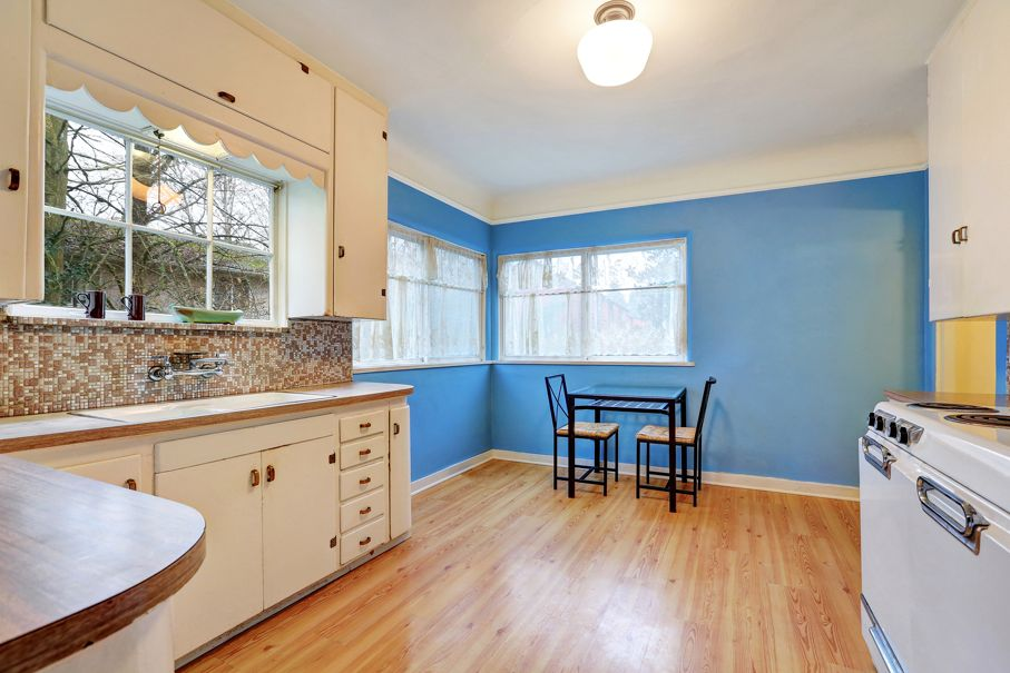 Bungalow kitchen and dining area with blue contrast wall hardwood floor kitchen