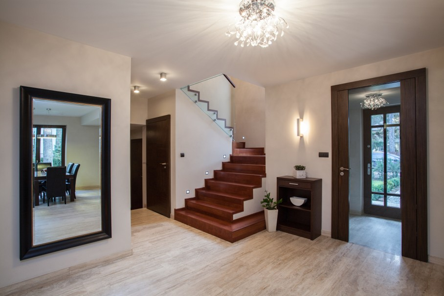 Travertine house: interior with hallway, stairs and entrance