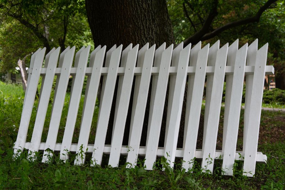 Section of the white wooden fence
