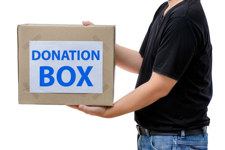 Man holding clothes donation box