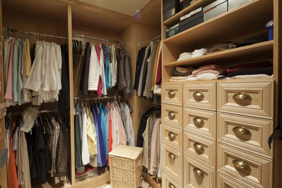 Walk in closet with organized clothing