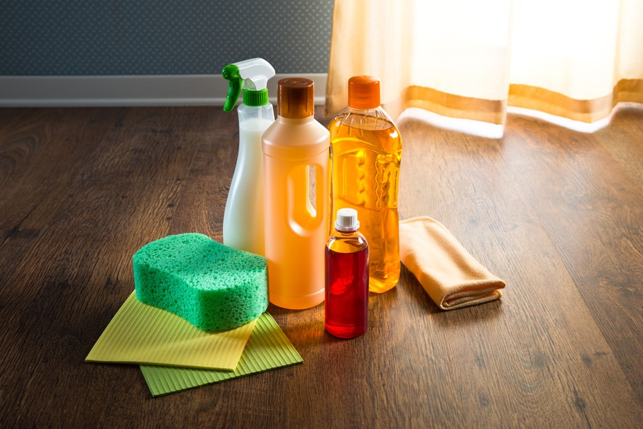 Wood floor cleaner products on parquet with sponges and microfiber cloth