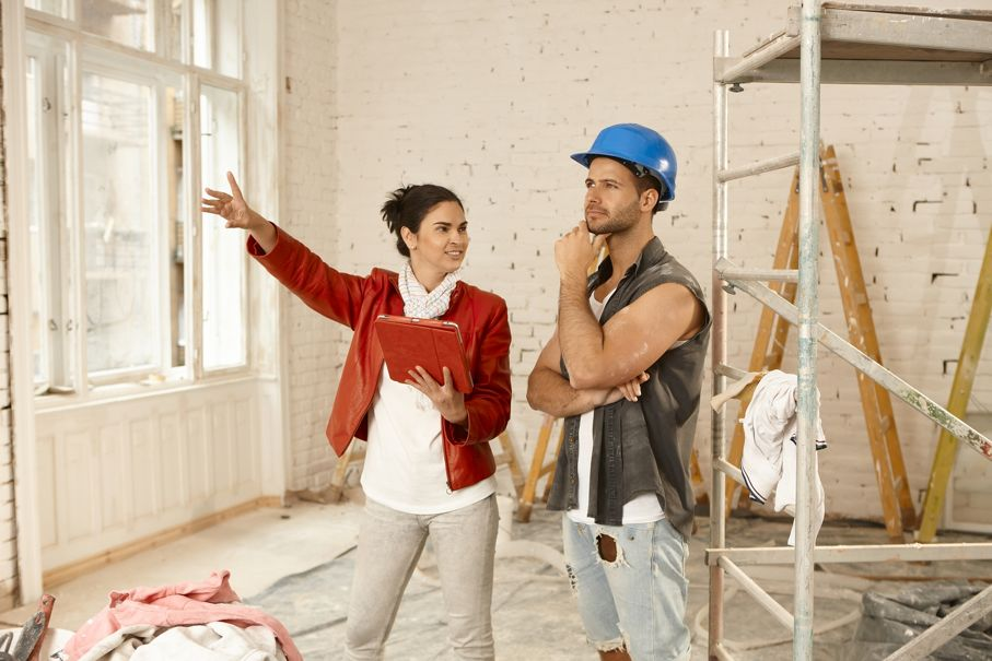 Female client and contractor talking at renovation site
