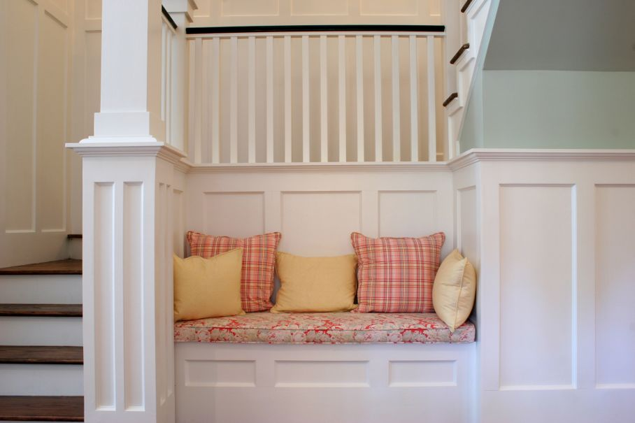 Recessed nook in staircase with bench and pillows