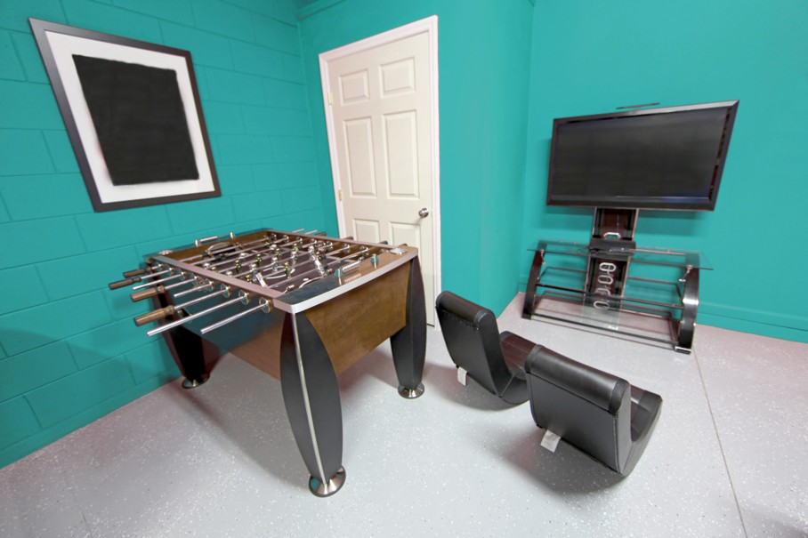 A Games Room with Foosball, TV and Gaming Chairs
