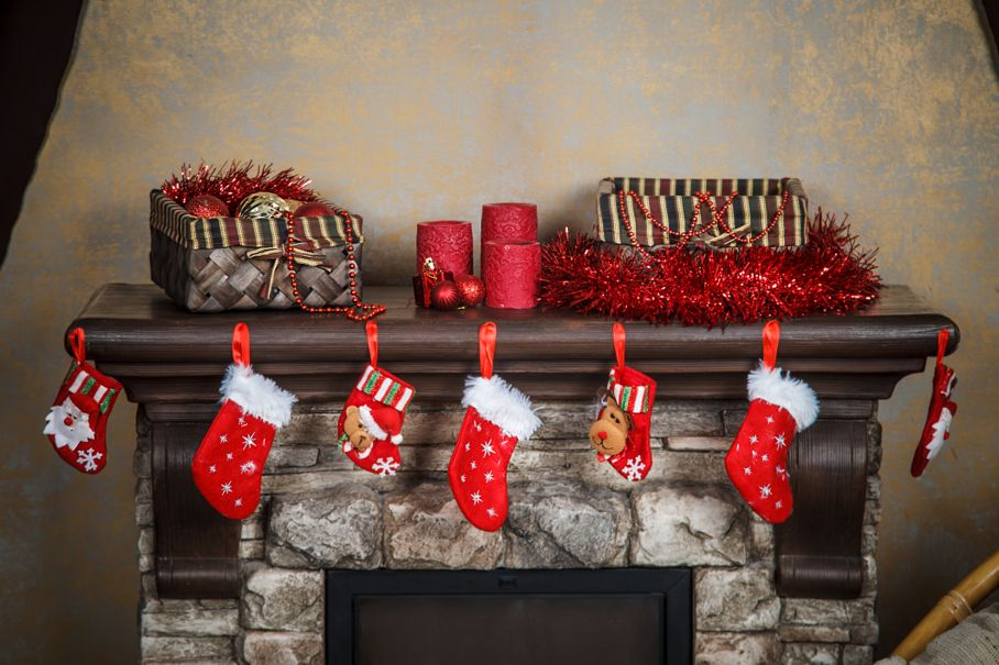 Christmas red stocking hanging from a mantel