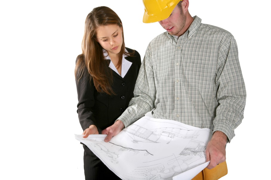 Working with a home builder inspecting the blueprints
