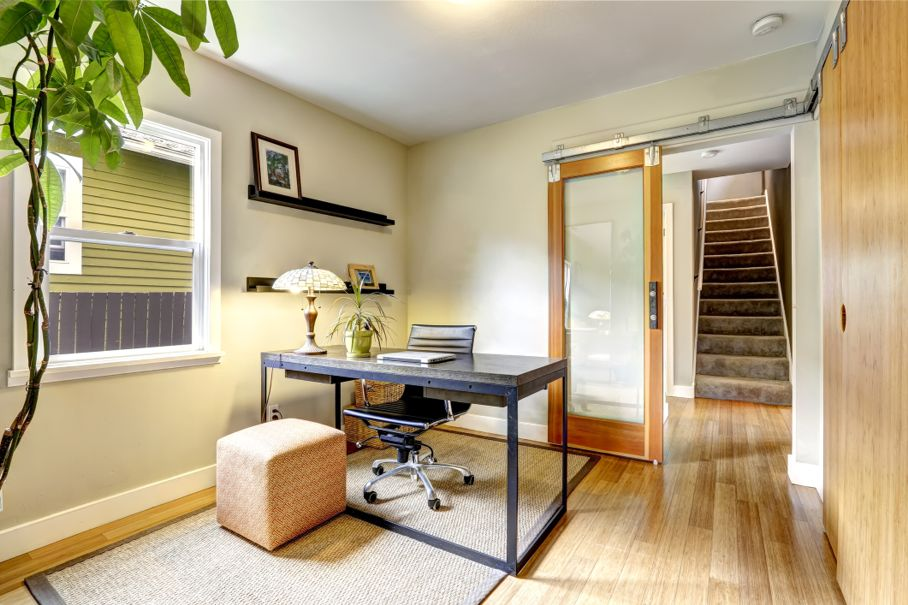 Small home office interior with hardwood floor.