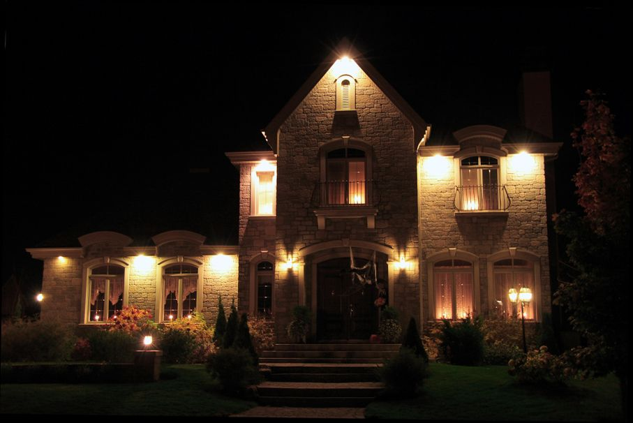 Illuminated, prestigious new house at night