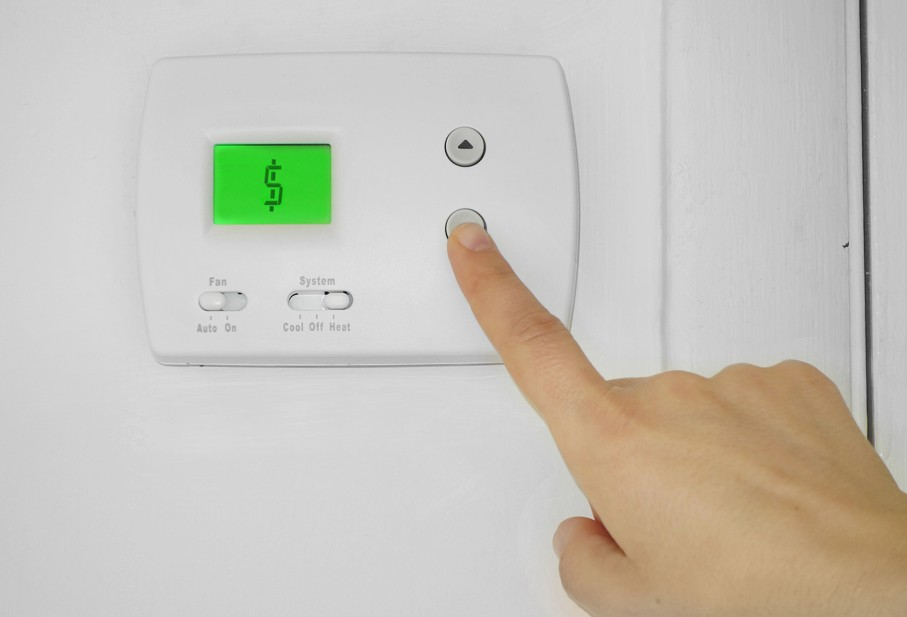 Thermostat with dollar sign symbol