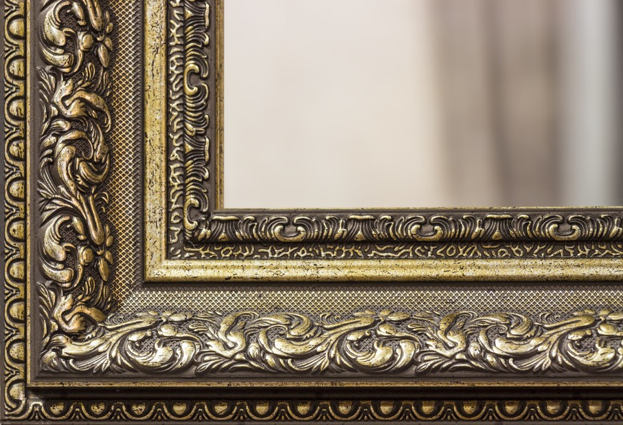 Part of the ornate, carved mirror frame in ancient style