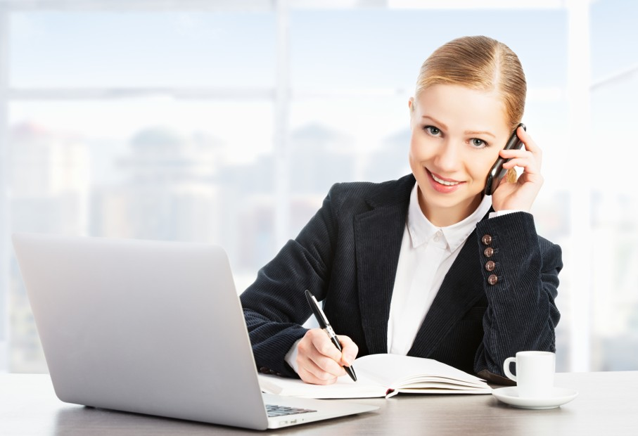 Business woman with a computer laptop and mobile phone