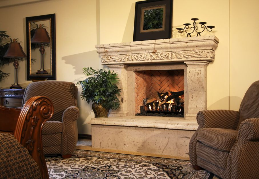 Large ornate fireplace warms this finely decorated bedroom suite