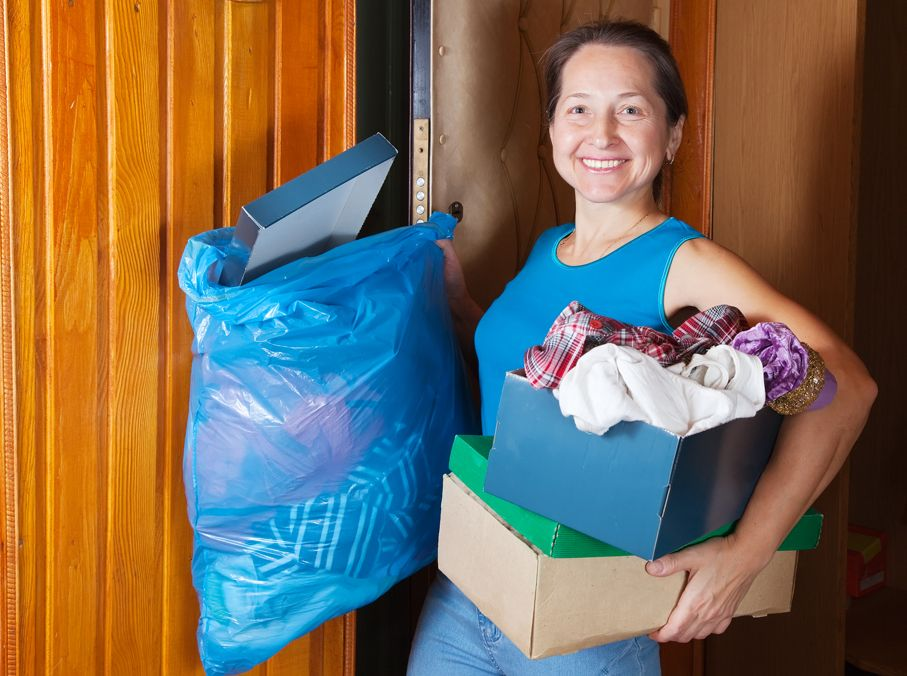 Woman taking away the garbage at home