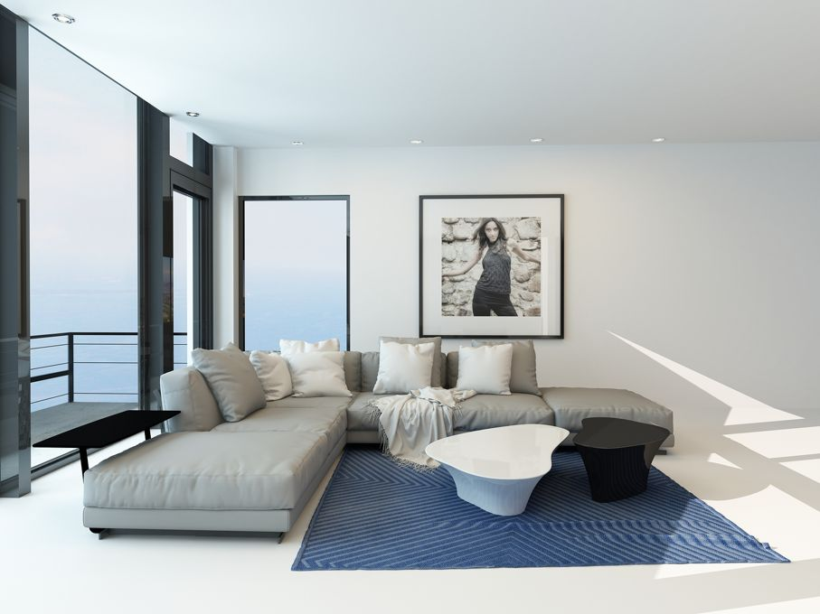 Waterfront living room with a bright airy lounge interior with a comfortable modern upholstered grey suite