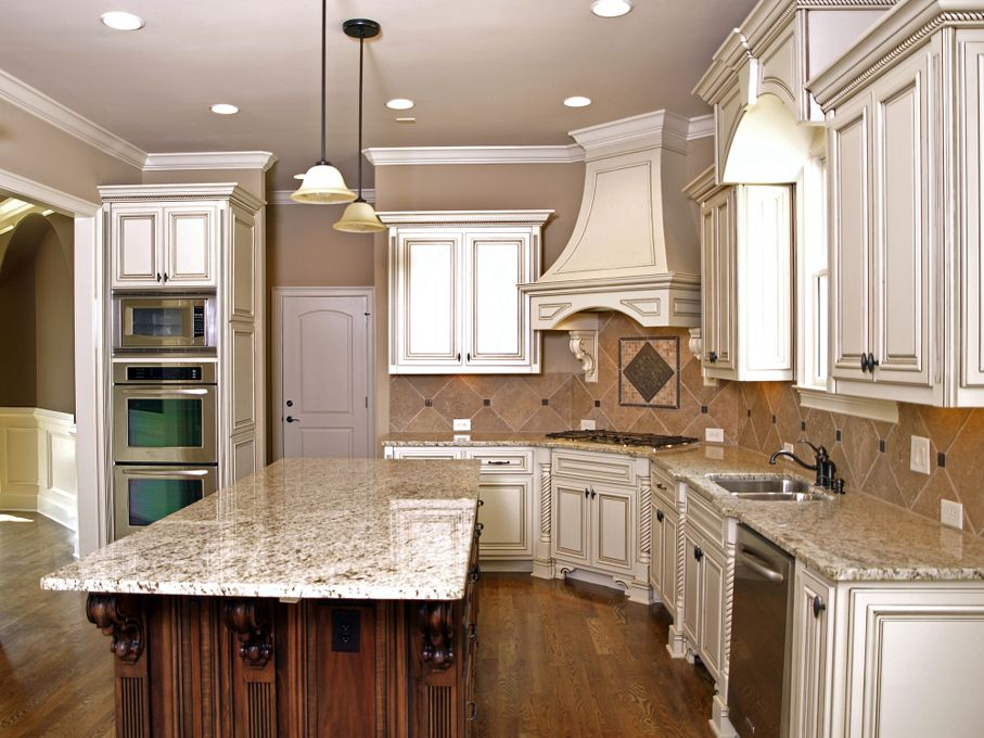 Luxury Kitchen with Granite topped Island and hardwood floors