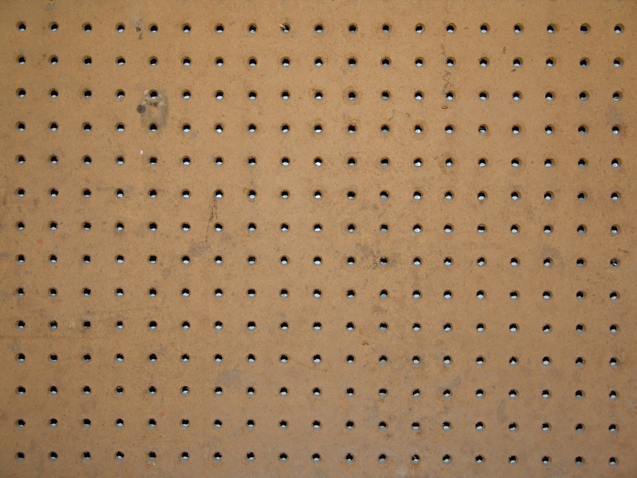 Peg board with holes for organizing