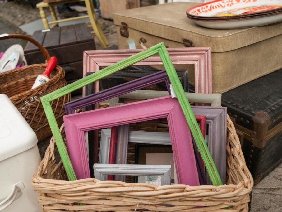 Differed coloured painted wood frames in a basket for sale