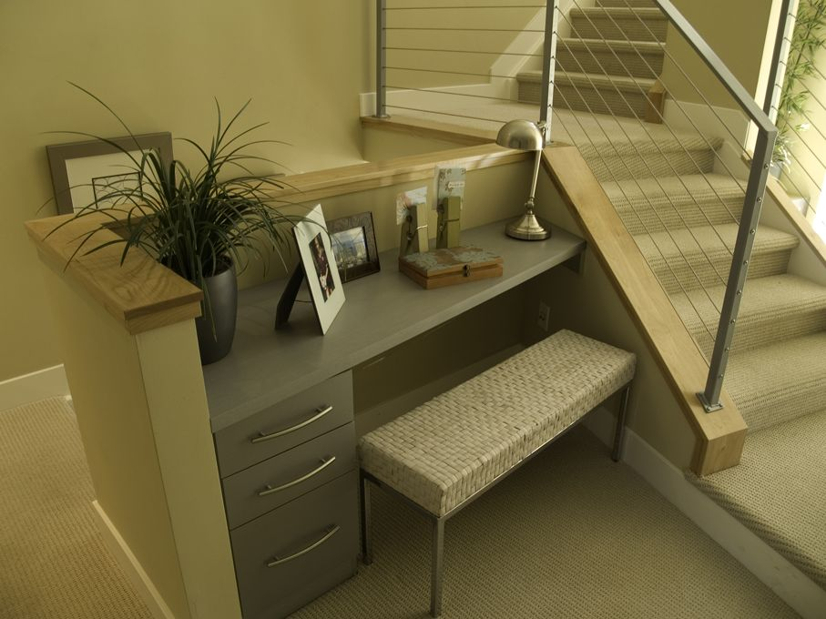 Small office nook on the stairs with a bench seat