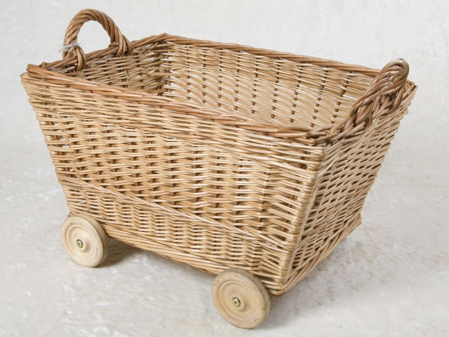 Hand-made wicker box on wheels with two handles