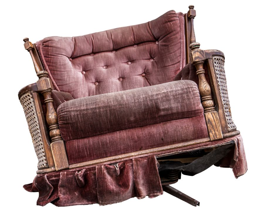 An Old Damaged Vintage Purple Armchair